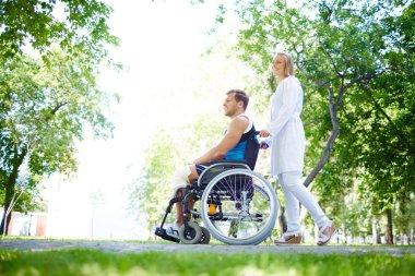 Nurse walking with male patient
