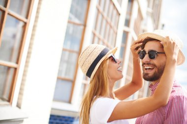 Girl and boyfriend in hats and sunglasses