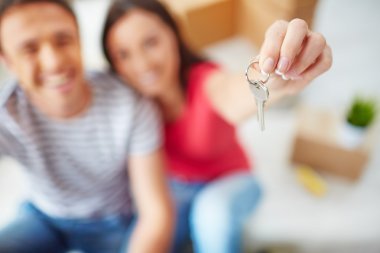 Woman showing key from new flat