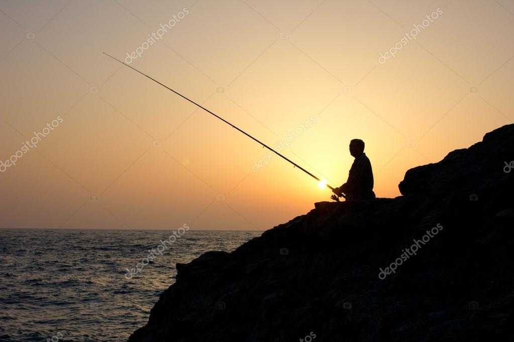 angler on sunset fishing