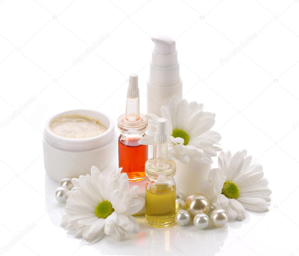 natural cosmetics products with pearls and flowers