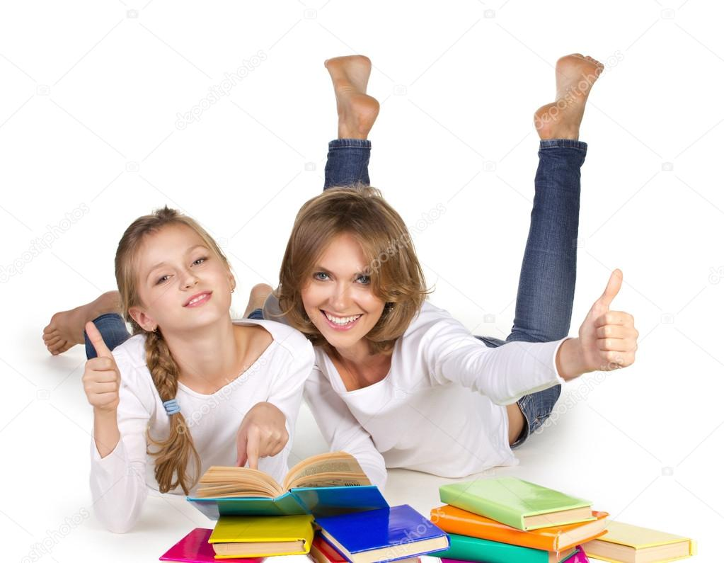 Mother and daughter couching reading books