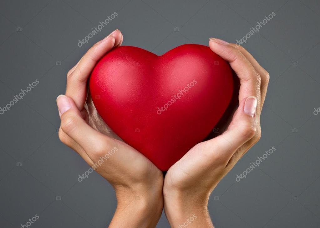 Heart in womans hands