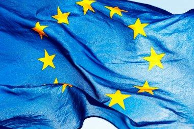 European union flag against the sky and sunlight stock vector