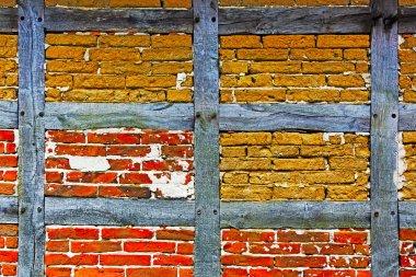 Old adobe and brick wall of half timbered house