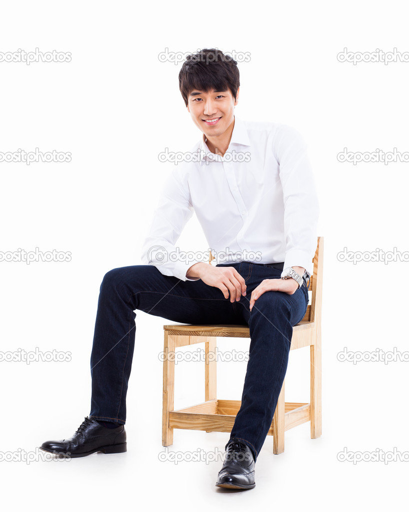 Young Asian person sitting on the chair. — Stock Photo ...