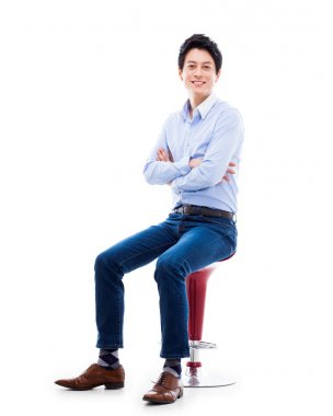Young Asian person sitting on the chair.