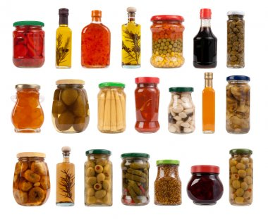Jars and bottles with pickles, sauces and olive oil