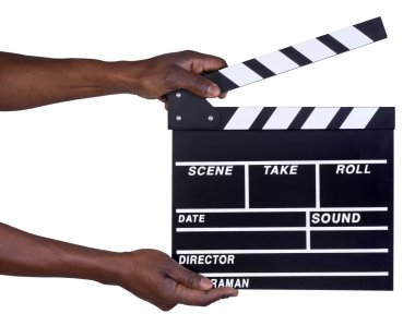 Man holding movie production clapper board