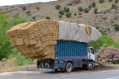Overloaded truck staying on road