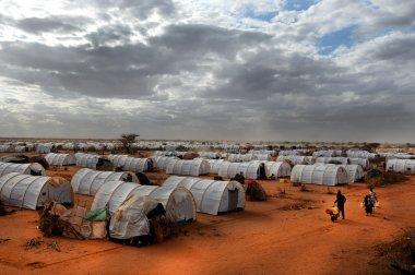 DADAAB, SOMALIA-AUGUST 07: Unidentified men, women & children wa