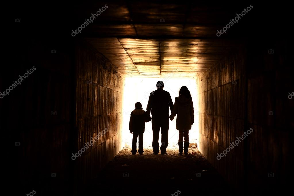 Family holding hands in the tunnel