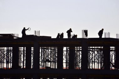 Silhouette of working and building construction