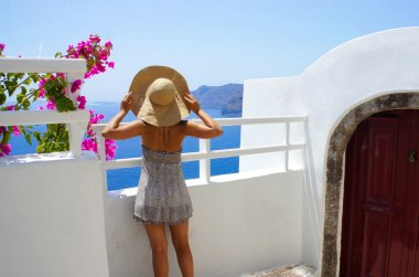 Young woman in straw hat, Santorini island