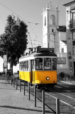 Lisbon old yellow tram over black and white background