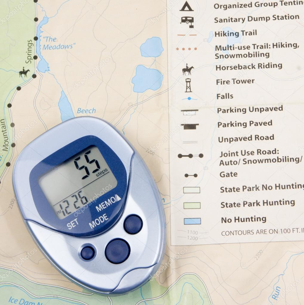 map pedometer — stock photo © enigmangels  - blue pedometer with a map in background — photo by enigmangels