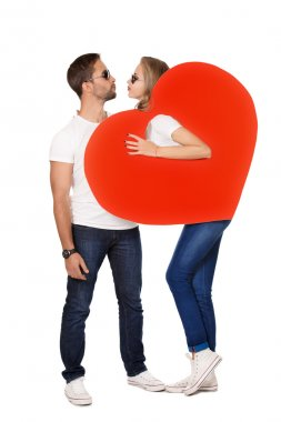 Happy young people in love posing with big red hearts. Isolated over white. stock vector