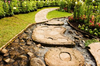 Landscape garden design. The path in the garden with pond in asi