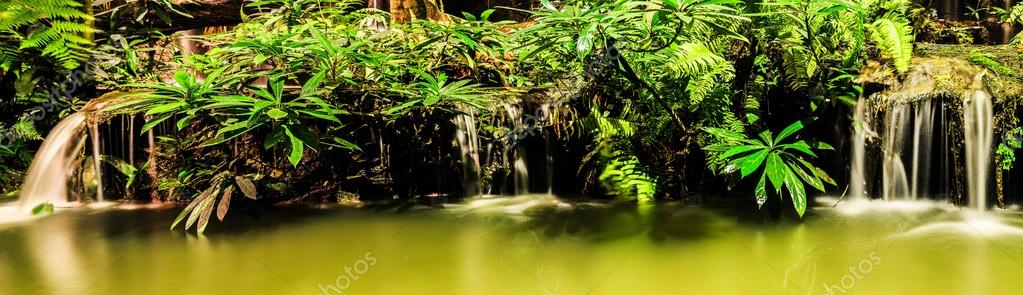 Panorama of waterfall in garden design.Shooting at night with tu
