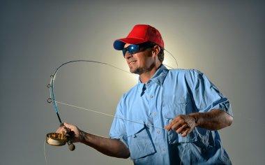 Fisherman and fishing rod
