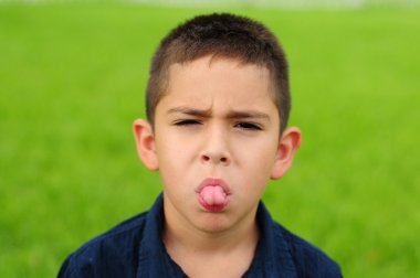 Child sticking out tongue