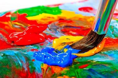 Art brush mixed paint on the palette stock vector