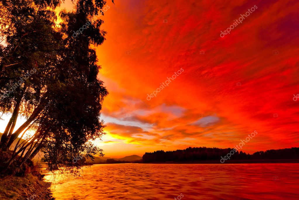Red sunset sky over the river Katun. Altai. Russia