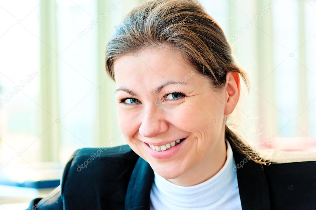 9e8bfdf8588 Clean modern portrait of a young professional business woman with ample  copyspace.