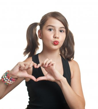 Teenage girl making in heart shape with her hands