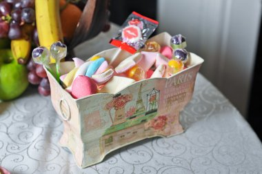 Nice wedding decorative box with colored candies and lollipops