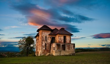 Old abandoned haunted house and sky in Transylvania with clouds. Abandoned mansion in ruins