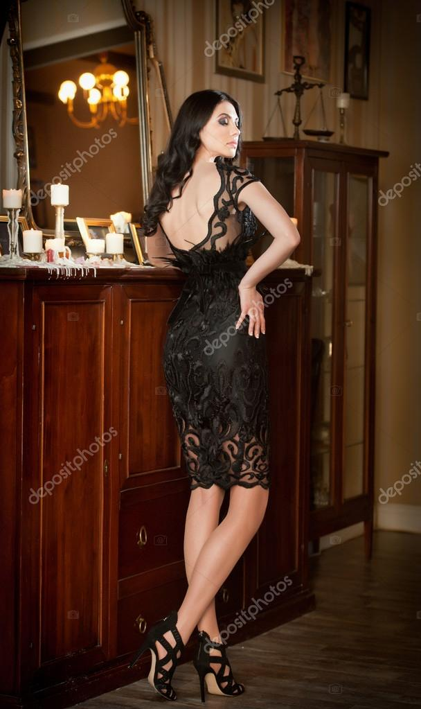 Brunette black lace dress are