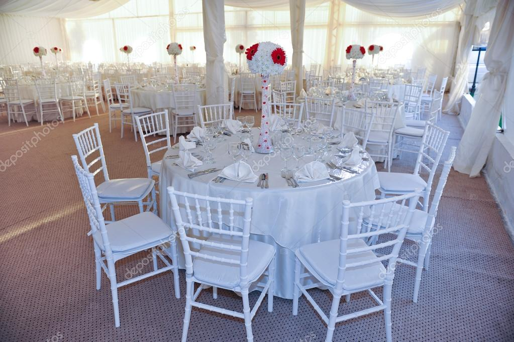 Wedding tables setting in white color. Tables set for an event party or wedding reception & Wedding tables setting in white color. Tables set for an event party ...