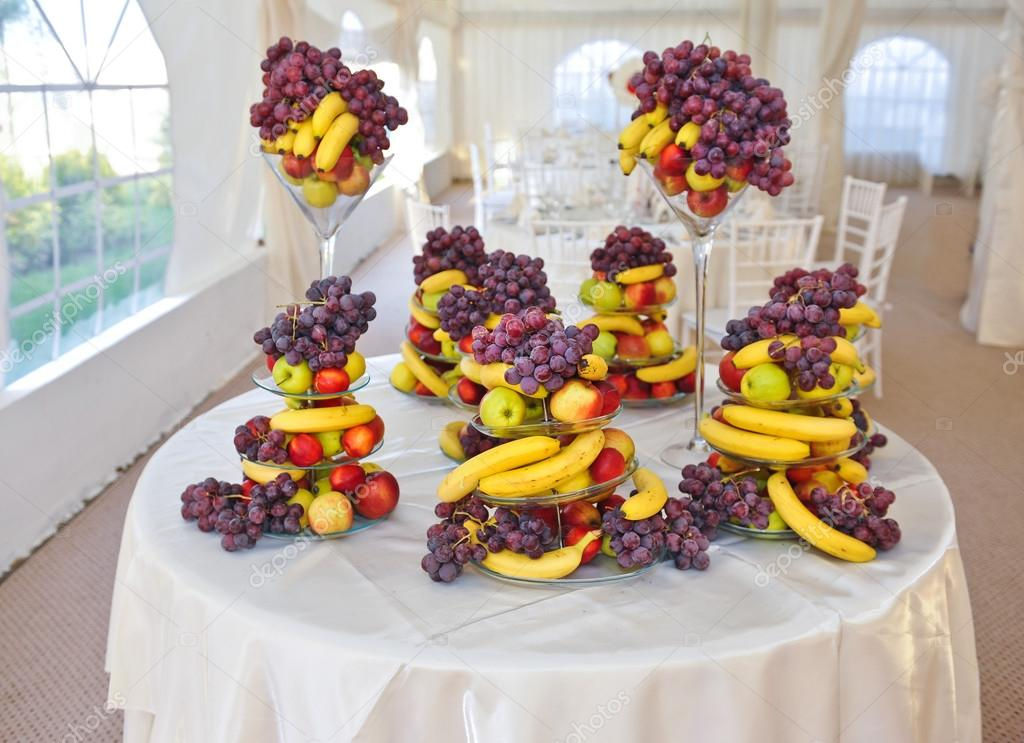 Fruits arrangement on restaurant table. Wedding decoration with ...