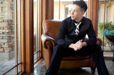 Male Model Wearing Formal Suit and Tie Sitting in Chair