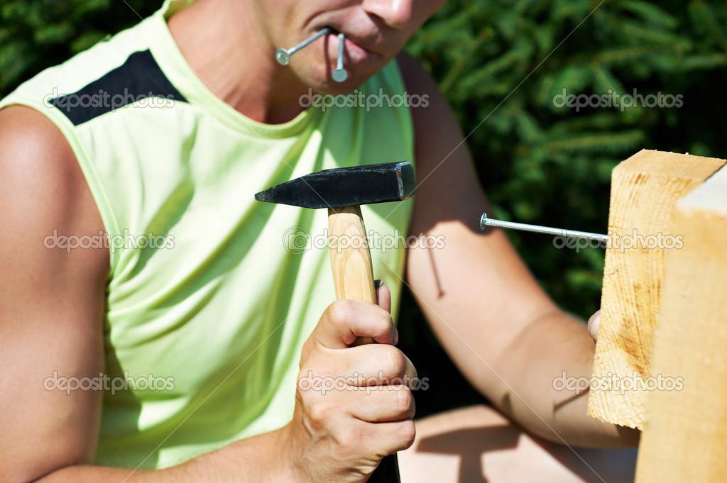 hombre que trabaja con un martillo — Foto de stock © ryzhov #36322865