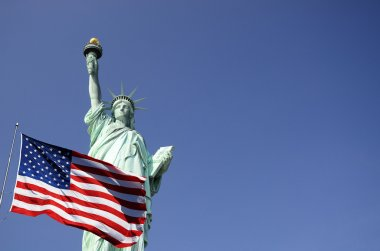 United States flag and Statue of Liberty