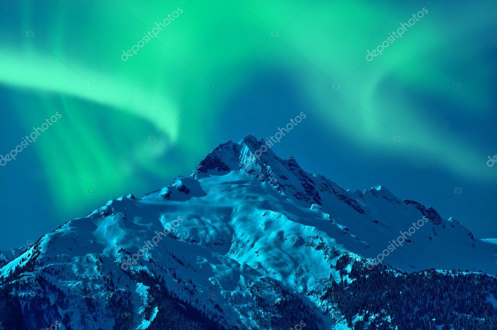 Snowy mountain with northern lights