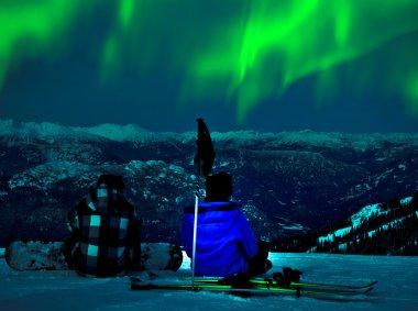 Northern lights over snow mountain peak