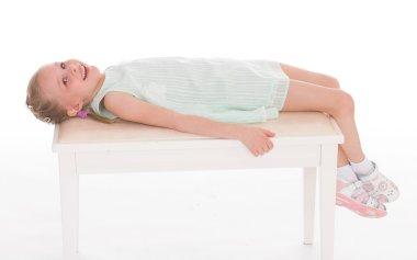 Portrait of a little girl lying.