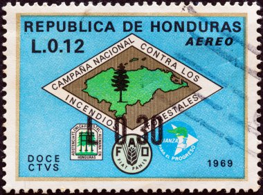 HONDURAS - CIRCA 1971: A stamp printed in Honduras shows Forest Fire Brigade emblem (with map of Honduras) and emblems of fire fighters, FAO and Alliance for Progress, circa 1971.