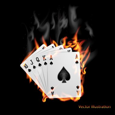 Poker cards burn in the fire.