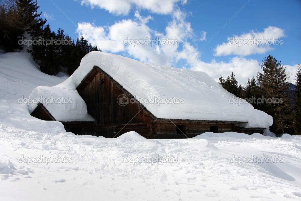 Winter landscape with Alpine cottage