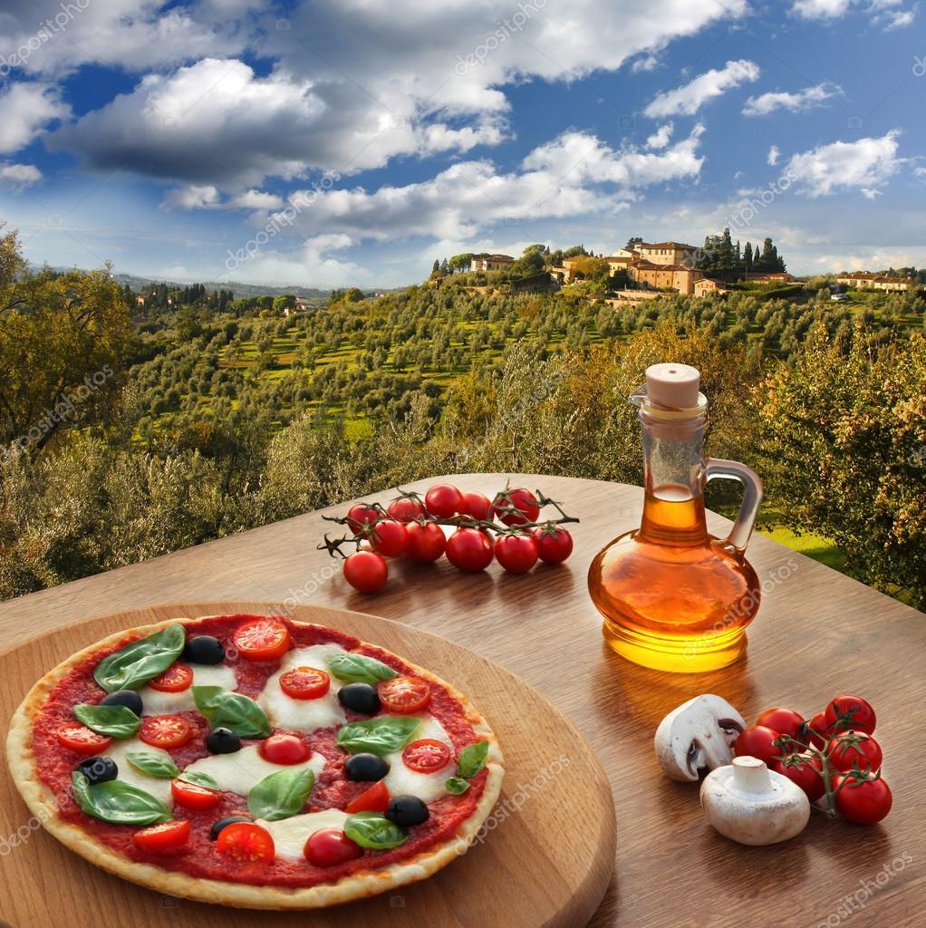 Italian pizza in Chianti, famous vineyard landscape in Italy