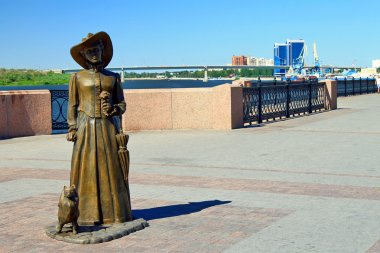 Sculptural composition of the lady with the dog. Astrakhan, Russia