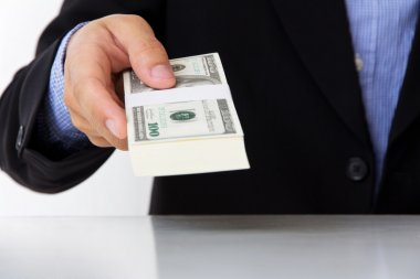 Business man giving money