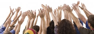 Men and women raising hands
