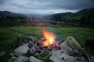 Camp fire in the mountains.