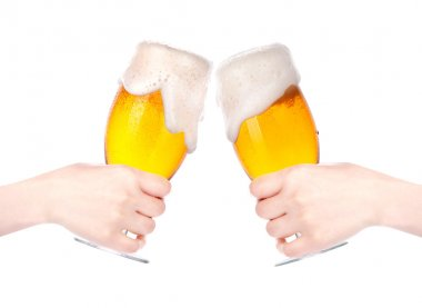 Pair of beer glasses with hand making a toast isolated