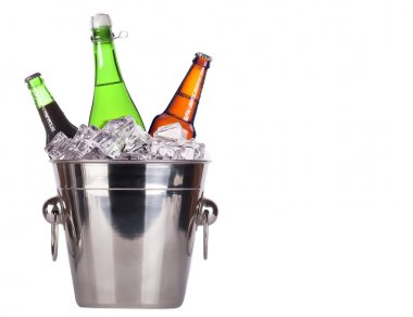 Champagne bottle in ice bucket and beer